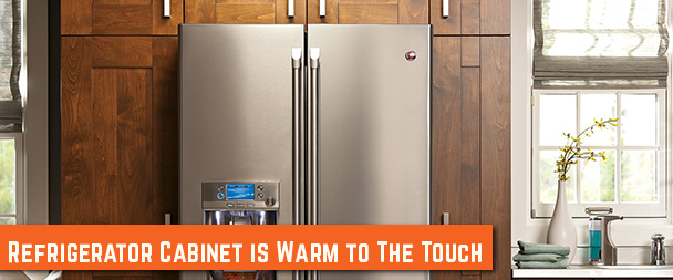 Refrigerator cabinet is warm to the touch